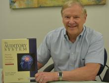 Dr. Frank Musiek with his new textbook