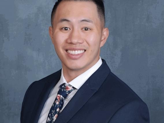 Headshot of Bryan Wong in coat and tie